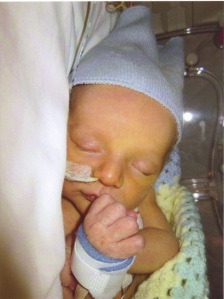 Samuel in the incubator in NICU